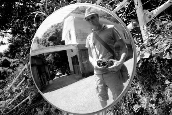 Self portrait in a traffic mirror.