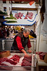Seller positions some select cuts of whale meat.